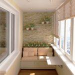 Sofa og sammenleggbart bord på balkongen
