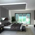 Black and white striped ceiling over the bed.
