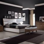 Matte black walls and ceiling in the bedroom