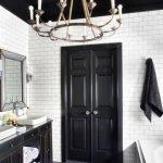 Stylish bathroom with black ceiling