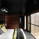 Modern bedroom with black ceiling