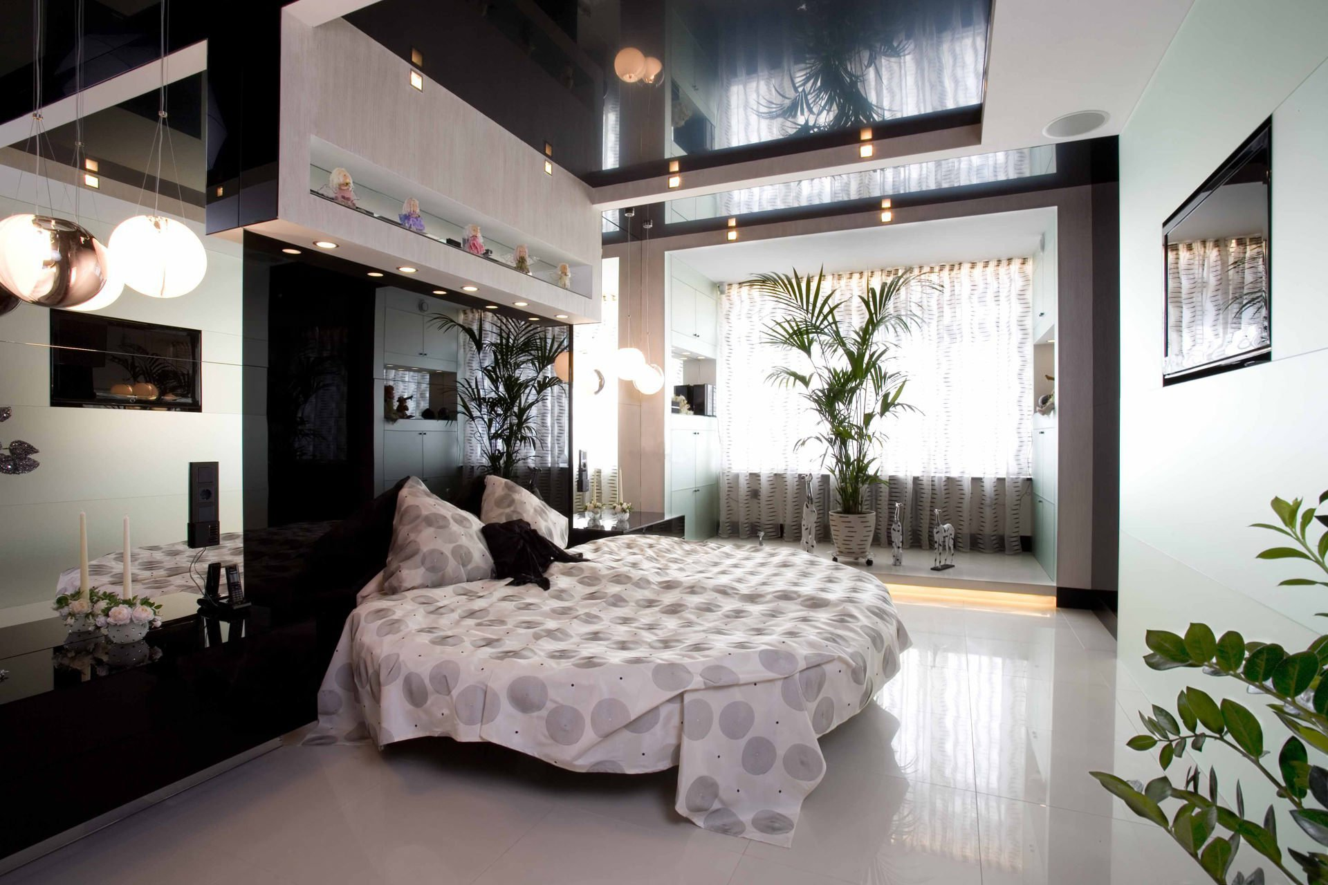 Black stretch ceiling in a modern bedroom
