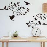 Grener med fugler på veggen