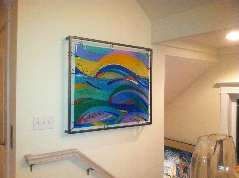 Een glazen plaat aan de muur monteren