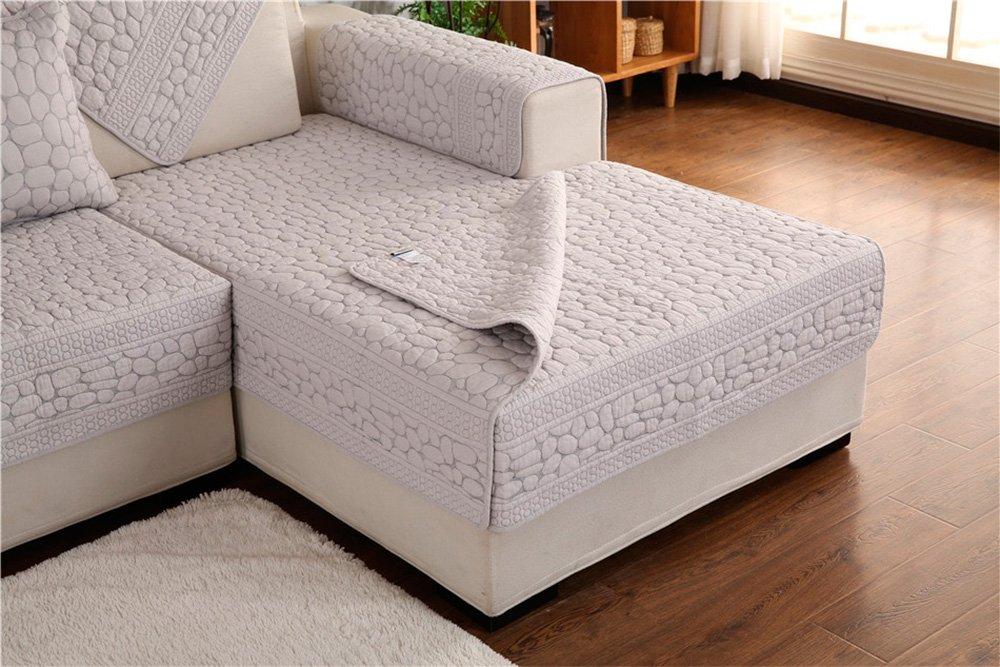 Couvre-lit de style moderne sur un canapé