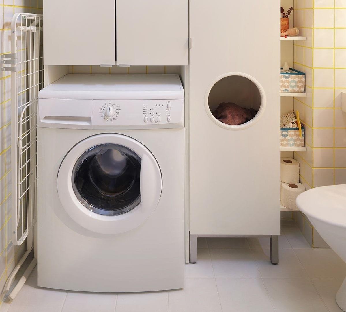 Placard au dessus de la machine à laver